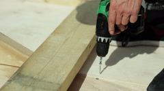 Carpenter works screwdrivers Stock Footage