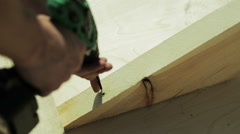 Carpenter spins screw screwdriver Stock Footage