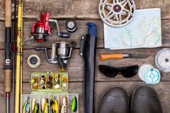 Fishing tackles for journey on wooden boards Stock Photos