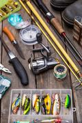 fishing tackles for journey on wooden boards - stock photo