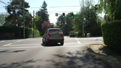 Front view of a Driving Plate: Car traveling on SW Mayfield Avenue in Beaverton, Stock Footage