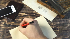 Man hand write letter on vintage background - stock footage