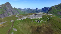 Hikers on Lofoten islands in Norway Stock Footage