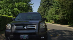 Rear view of a Driving Plate: Car traveling on SW Mayfield Avenue in Beaverton, Stock Footage