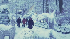 People walking in the park early in the morning in the winter of slow motion Stock Footage