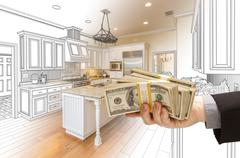 Hand Handing Cash Over Kitchen Design Drawing and Photo Combination Stock Photos