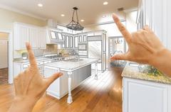 Female Hands Framing Custom Kitchen Design Drawing and Photo Combination. Stock Photos