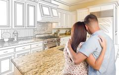 Young Military Couple Inside Custom Kitchen and Design Drawing Combination Stock Photos
