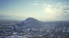 City in winter with snow roofs shot from high viewpoint-timelapse Stock Footage