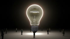Typo 'E-Commerce' in light bulb and surrounded businessmen, idea concept version - stock footage