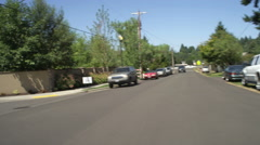 Front view of a Driving Plate: Car turns left from SW Mayfield Avenue onto Stock Footage