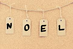 Vintage grunge tags with word NOEL - stock photo