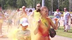 Mass marathon of newcomers in summer park, Holi festival of colours, running Stock Footage