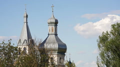 Domes of Orthodox Church against background of blue sky Stock Footage