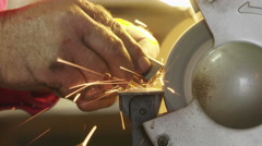 Man grinding metal with power tool. Stock Footage