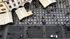 Aerial view on the people who pass through the market square in Prague Stock Footage