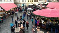 People pass and have some refreshment on the market square - stock footage