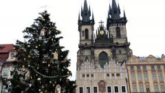 Christmas tree and the Cathedral in Old Town Square in Prague Stock Footage