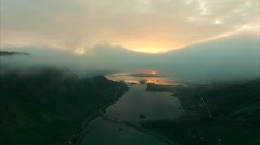 Midnight sun from above the clouds on Lofoten Stock Footage