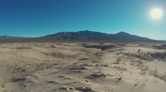 Ultra Wide Shot Of Mojave Desert Mountains Sun Sand Stock Footage