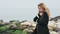 sad pensive woman looking at the sea - stock footage