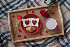 Valentines day breakfast in bed sweet romantic present, red rose flower Stock Photos