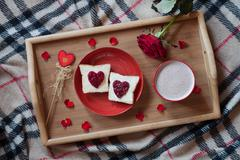 Delicious breakfast in bed on valentines day celebration holiday romantic Stock Photos