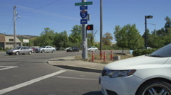 Right Side view of a Driving Plate: Car turns left from Edenbower Boulevard in Stock Footage