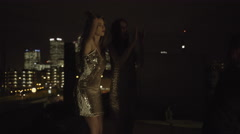 Female Friends party on rooftop at night with sparklers Stock Footage