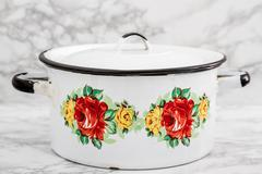 Empty White Vintage Enamel Saucepan with Flower Design Stock Photos