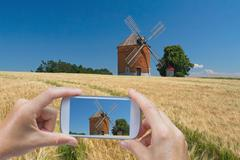Taking pictures by smart phone (brick windmil, Czech Republic) - stock photo