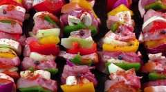 Raw pork skewers ready for grilling - stock footage