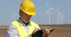 Technical Staff Write Maintenance Report Agenda Inspecting Wind Turbines Field Stock Footage