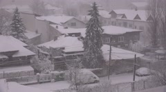 Snowfall over houses and cars, Christmas scenery outdoor, wind blowing snow 4K - stock footage
