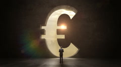 businesswoman standing in front of a euro sign - stock footage