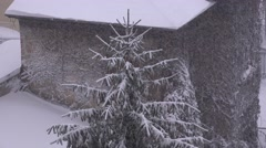 Abundant snow storm over Christmas tree, white landscape, first snow in town 4K Stock Footage