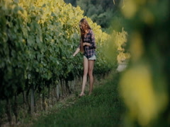Beautiful girl walking on the vine rows Stock Footage