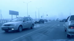 Stock Video Footage of snowing while driver comes close to the crossroads