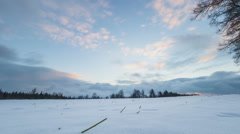 sundown on a clearing with snow in a timelapse video - stock footage