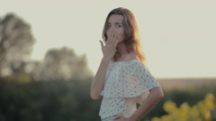 Fashionably dressed girl in a short skirt walks along the vineyard - stock footage