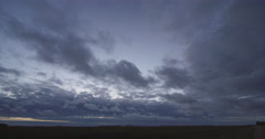 Low clouds advancing over farmland Stock Footage