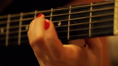 Acoustic black guitar playing - stock footage