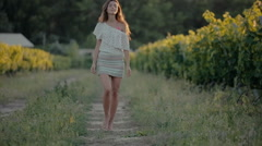 Shy girl goes along the grape rows - stock footage