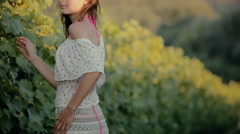 Cute girl posing near the vine Stock Footage