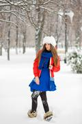 Attractive young woman in wintertime outdoor. - stock photo