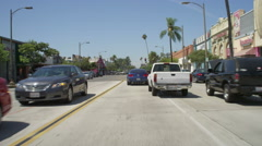 Front view of a Driving Plate: Car travels east on Colorado Boulevard in Stock Footage