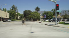 Right Side view of a Driving Plate: Car travels east on Colorado Boulevard in Stock Footage