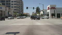Front view of a Driving Plate: Car travels on East Colorado Boulevard through Stock Footage