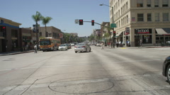 Front view of a Driving Plate: Car travels on Colorado Boulevard through Stock Footage