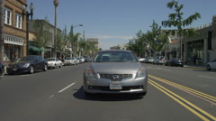 Rear view of a Driving Plate: Car travels from Pasadena Avenue on West Colorado Stock Footage